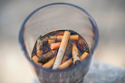 Photo: A cup filled with cigarette butts in Lincoln, Nebraska.
