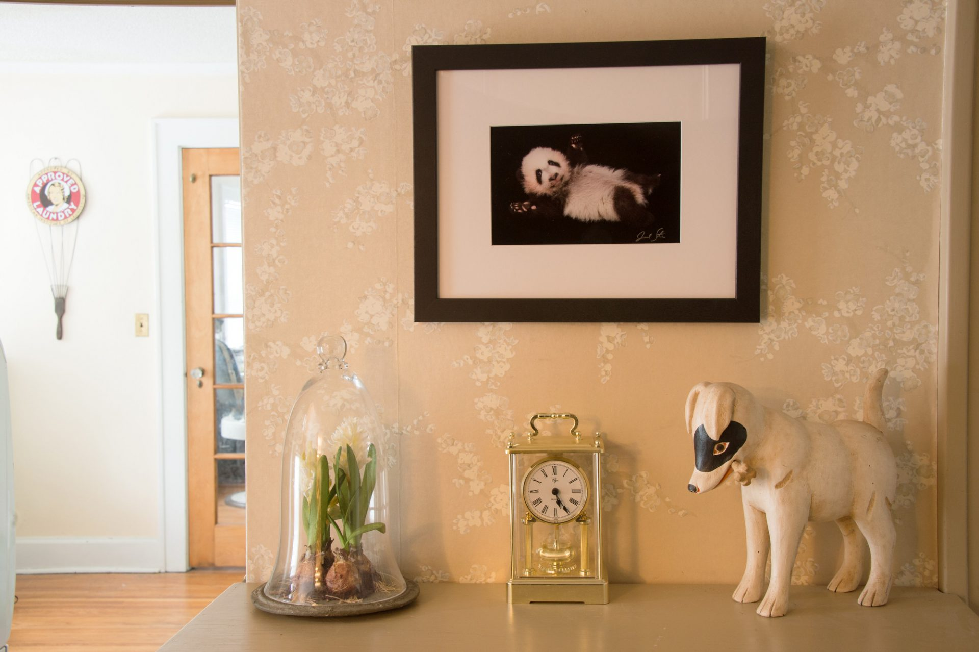 Photo: A framed and matted print of a baby panda.