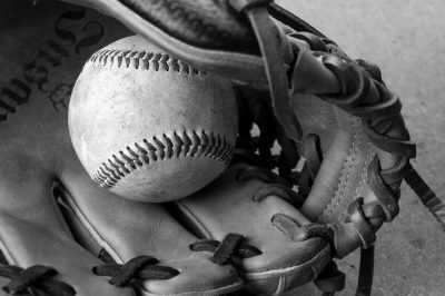 Photo: Detail shot of a baseball and baseball glove.