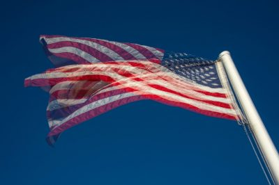 Photo: An American flag flies in the breeze in a double exposure.