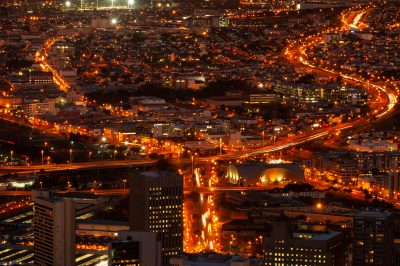 Photo: A stream of traffic at night in Cape Town, South Africa.