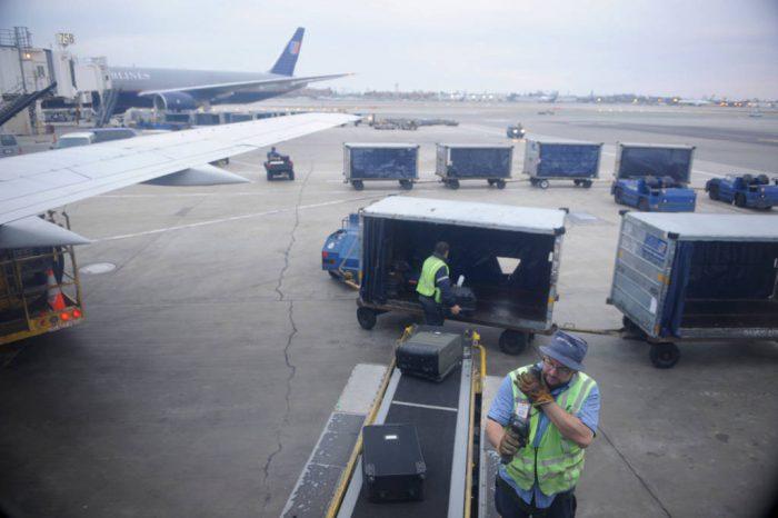 Photo: Baggage handlers at the LA Airport.