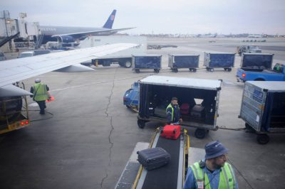 Photo: Baggage handlers at the LA Airport.
