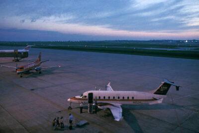 Photo: Passengers prepare to board an airplane.