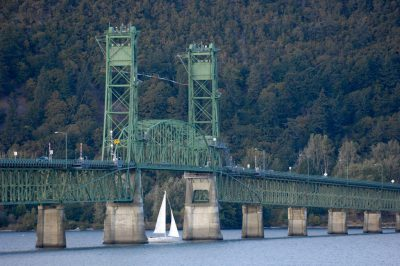 Photo: A bridge lifts to that a sailboat can pass under along the Columbia River at Hood River, Oregon.