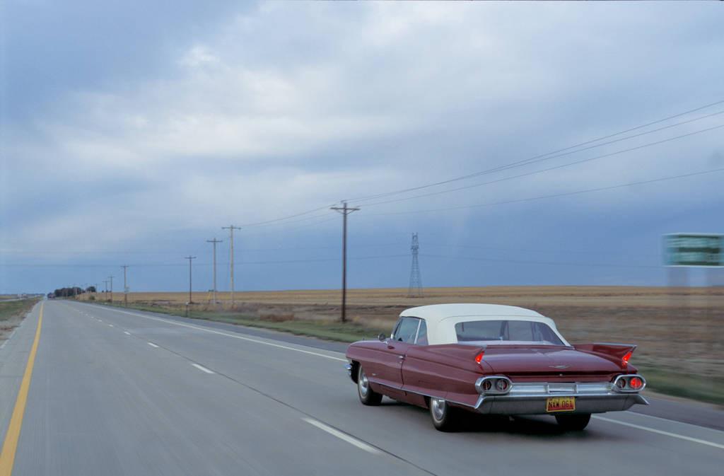 Photo: 1961 Cadillac convertible moves down a Nebraska road.