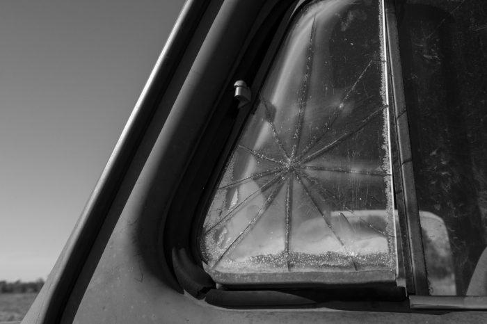 Photo: A window is cracked on an old International Harvester truck in Bennet, Nebraska.